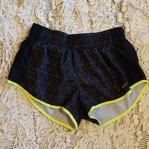 Black and neon green workout shorts